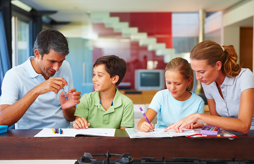 Mother and father helping children with homework
