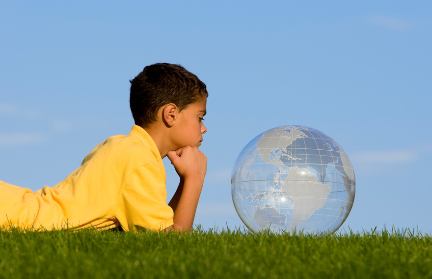 Boy looking into translucent globe